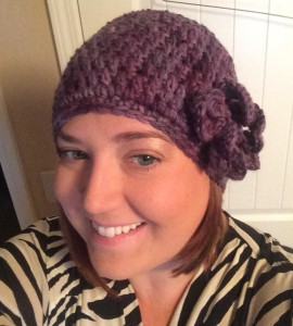 Stephanie Bollman is showing off her crocheted hat that was custom dyed in Amethyst for her.