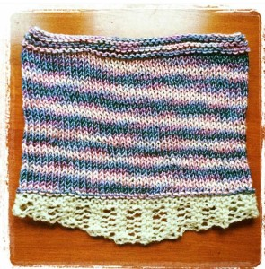 Rachel Hansen knit up this beautiful cowl using my Sandy Bay Sunrise colorway. She then added a white lacy edging to it.