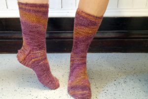 Here is the Celtic Sunset colorway dyed on 100% wool from Northern Woolen Mill knit into socks by Stephenie Anderson, using the Rye socks pattern.