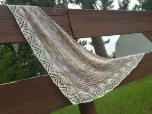 Linda Bissell created this wonderful Dream Stripes shawl with one skein of Itasca in the Fall and white merino/silk from Habu Textiles. She can often be found showing it off around town!