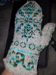 A Snowflake in Killarnery mittens made with my Quiet Reflections colorway as the contrast color and gray tweed as the main color. Pattern design is by Kirei Knitting Designs.