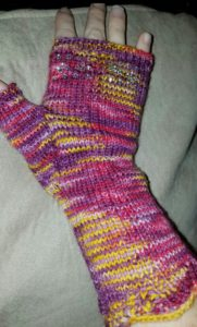 Sleekit fingerless gloves, designed by Star Rabinowitz, knit in my Celtic Sunset colorway with beads added.
