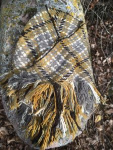 Alethea Kenney used a triangle loom to weave this wonderful earthy toned shawl. She used my Destinations Unknown colorway dyed on 100% wool from Northern Woolen Mill and white, gray, and black wool spun from her own sheep.