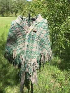 Alethea Kenney weaved this triangle shawl on a triangle loom with gray 100% wool from her sheep and my Quiet Reflections colorway, also dyed on 100% wool.